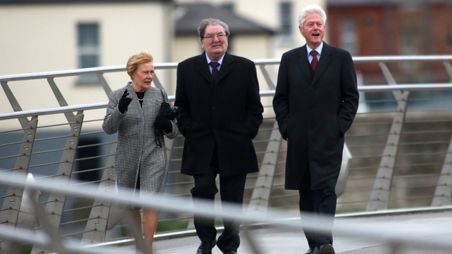 Mr Clinton along with John Hume and his wife Pat cross the peace bridge in Derry (Pic: EPA)