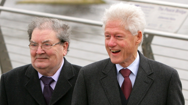 Mr Clinton and Mr Hume crossed the bridge linking divided communities in the city