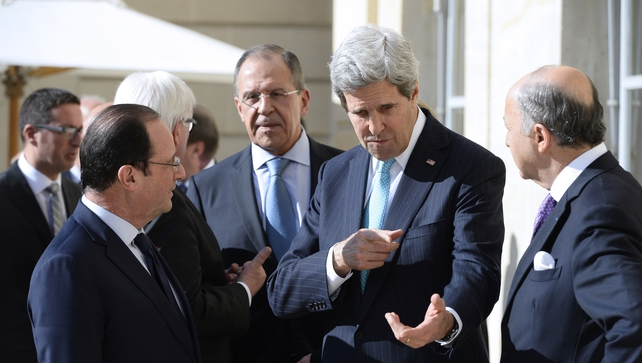 US Secretary of State John Kerry,  Russian Foreign Affairs Minister Sergei Lavrov, French Foreign Affairs Minister Laurent Fabius, and German Foreign Minister Frank-Walkter Steinmeier hold discussions at the Elysee presidential palace