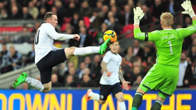 Wayne Rooney controls with Kasper Schmeichel looming