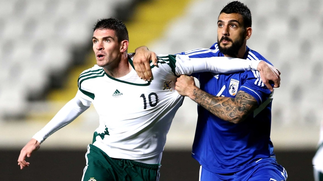Cyprus' Giorgos Merkis battles with Northern Ireland's Kyle Lafferty