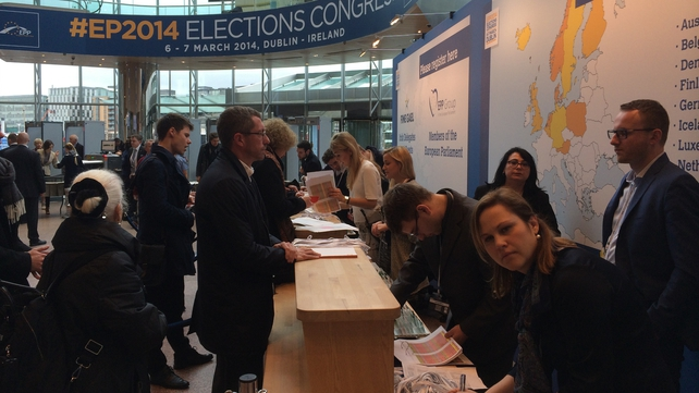 Delegates registering at the event this morning