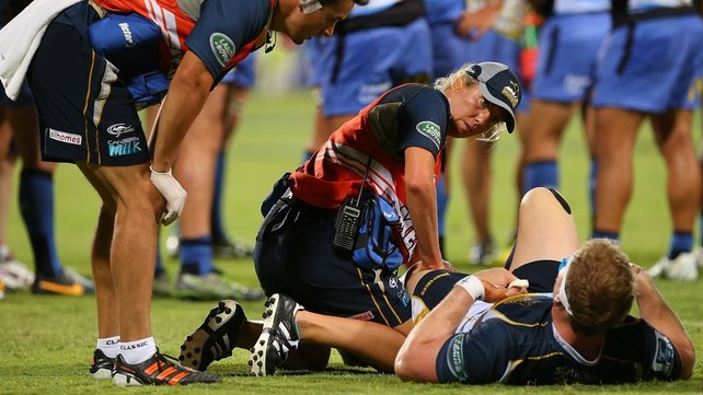 David Pocock receives medical attention after injuring his knee playing for the Brumbies against the Western Force