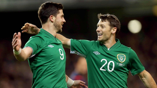 Shane Long and Wes Hoolahan celebrate Ireland's goal