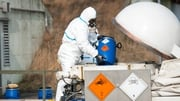 An employee of German company GEKA demonstrates the destruction of chemical weapons (P