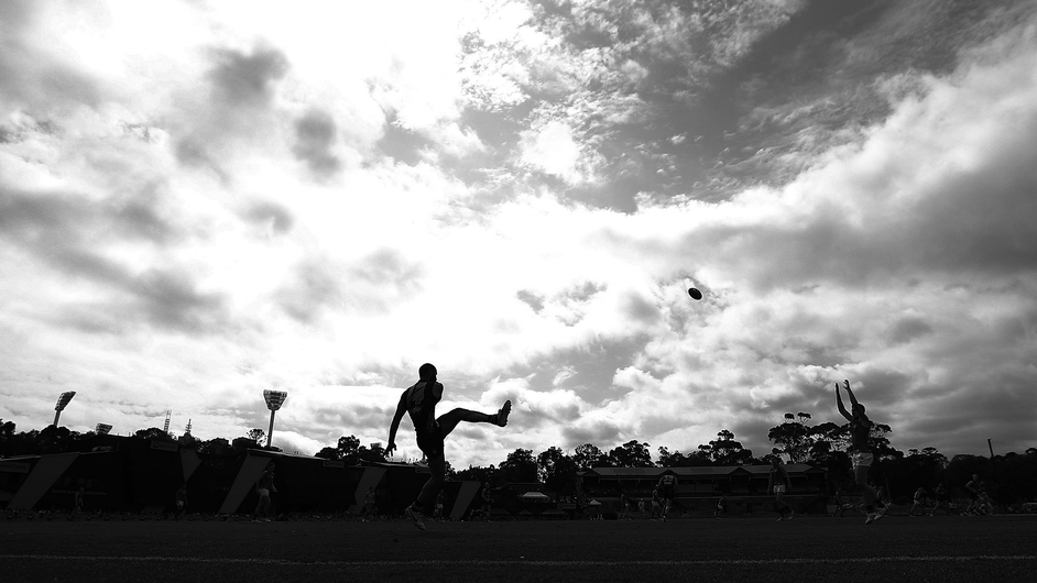 Bachar Houli of the Tigers kicks the ball during an AFL Practice Match between the Richmond Tigers and the Essendon Bombers in Melbourne