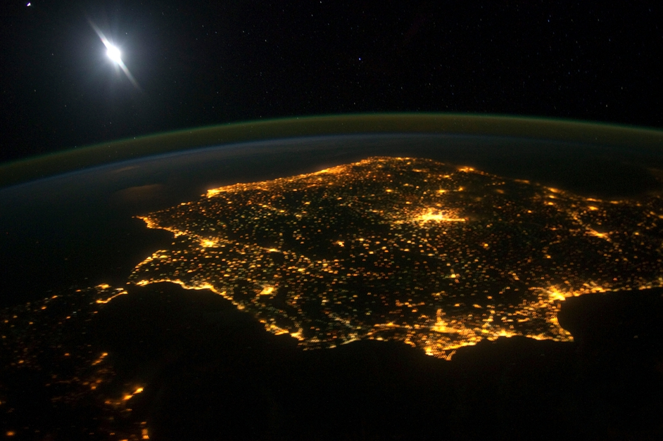 A picture taken from the International Space Station showing the Iberian Peninsula at night. The large mass of light in the middle is Madrid, Spain