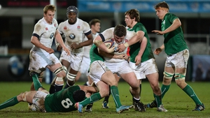 Max Abbott (tackler, right) in action for Ireland's under-20s against England in February