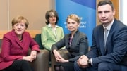 German Chancellor Angela Merkel met Ukrainian politicians Yulia Tymoshenko and Vitaly Klitschko at the summit (Pic: EPA)