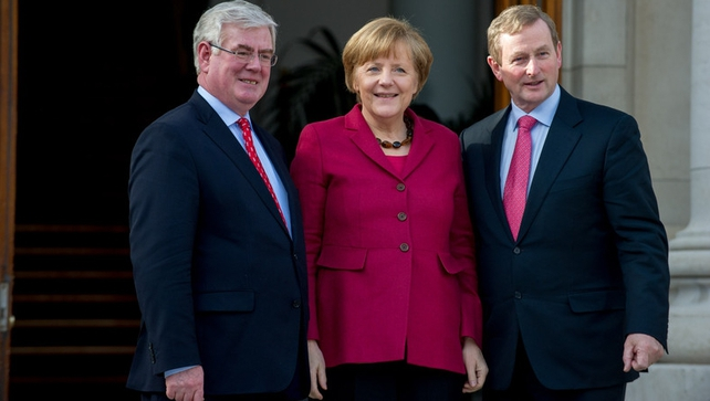 Angela Merkel was welcomed by Eamon Gilmore and Enda Kenny at Government Buildings this afternoon (Pic: EPA)
