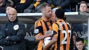 Newcastle United manager Alan Pardew throws his head at Hull City and Ireland midfielder David Meyler