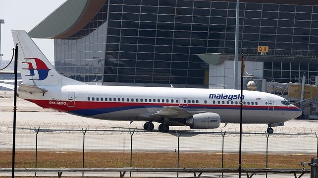 Malaysia Airline passenger jet  shown parked on the tarmac at the Kuala Lumpur International Airport