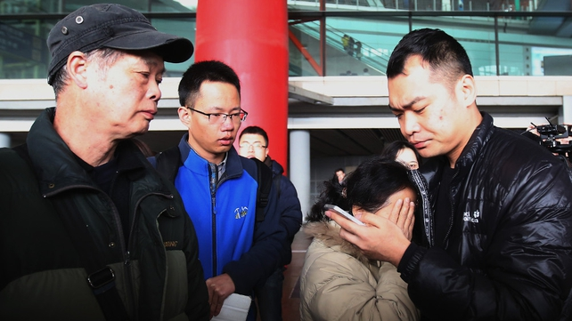 A relative of a passenger onboard Malaysia Airlines flight MH370 cries as she waits for news at Beijing International Airport