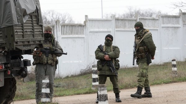 Armed men in military uniform stand guard in the territory of a Ukrainian military unit in Sevastopol (Pic: EPA)