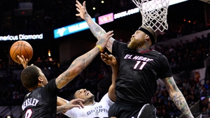 Miami Heat players Michael Beasley (L) and Chris Anderson (R) block a shot against San Antonio Spurs player Boris Diaw (C) of France in the second half of their NBA basketball game in Texas (Pic: EPA)