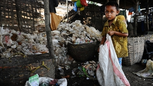 A young boy scavenges garbage from a landfill at Benowo in Surabaya, Indonesia