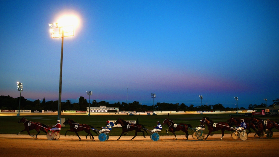 Horses and drivers finish the Jacobsen Headstones Handicap Trot during the 2014 Auckland Trotting Cup in New Zealand