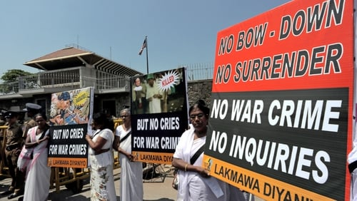 Pro-government activists marched towards US Embassy in Colombo where they shouted slogans against proposed war crimes investigation (Pic: EPA)