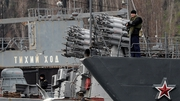A Russian soldier patrols the small anti-submarine ship 'Muromets' in the port of Sevastopol
