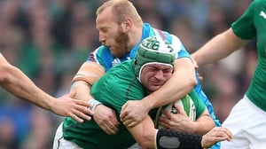 Rory Best is tackled by Italy's Leonardo Ghiraldini