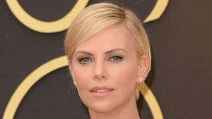 Charlize Theron says it's tough being beautiful in Hollywood. Who knew?