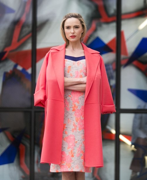 Sarah Morrissey wears a MaxMara Coat €1350 with a Fee G Bodycon Neon Print Dress €235