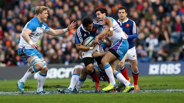 Scotland's David Denton, Johnnie Beattie and Alex Dunbar tackle France's Maxime Mermoz