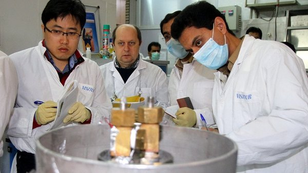 A team from the International Atomic Energy Agency checks the enrichment process inside a uranium enrichment plant in central Iran