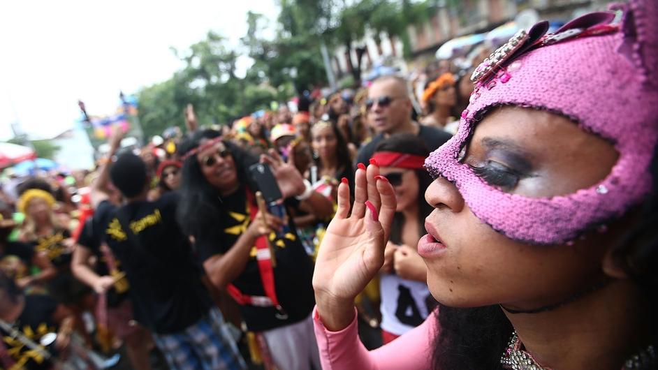 Revelers celebrate during the Quizomba street carnival 'bloco' on  in Rio de Janeiro, Brazil