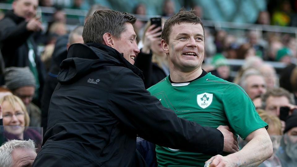 Brian O'Driscoll is congratulated by his long-time Ireland teammate Ronan O'Gara