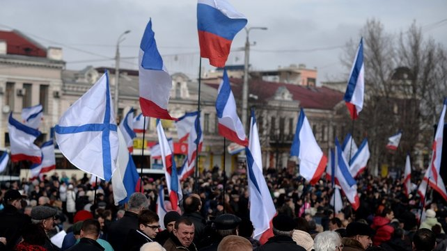 People gather at a pro Russian rally in Simferopol's Lenin Square in Crimea