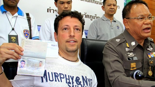 Italian tourist Luigi Maraldi who reported his passport stolen in August 2013, shows his current passport at a press conference in Thailand (Pic: EPA)