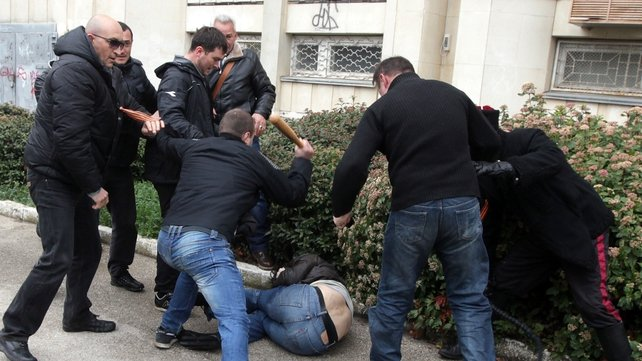 A man is beaten during clashes of Pro-Russian and Pro-Ukrainian activists during a rally in Sevastopol (Pic: EPA)