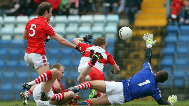 Cork's James Loughrey, Michael Shields and Ken O'Halloran deny Enda Lynn of Derry a goal chance