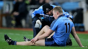 Ciarán Kilkenny on the Croke Park turf after picking up his injury