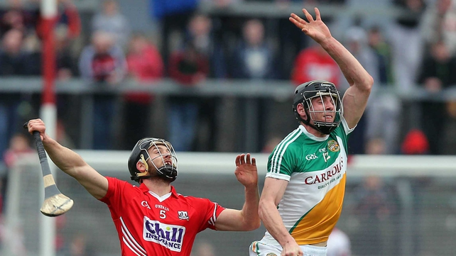 Eoin Cadogan of Cork with Conor Mahon of Offaly