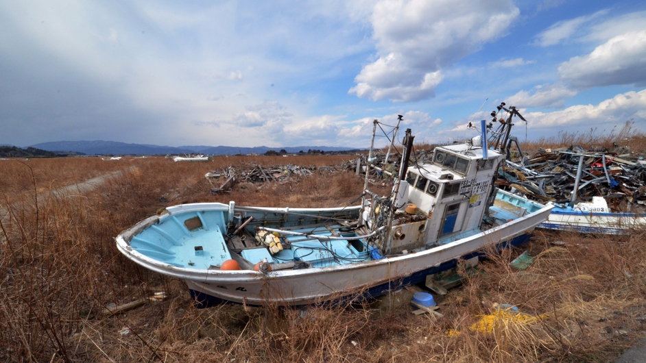 Fishing boats sit grounded on land in Namie three years after a massive earthquake and tsunami hit the Japanese region