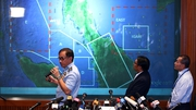 Officials identify the search area at a media briefing in Kuala Lumpur