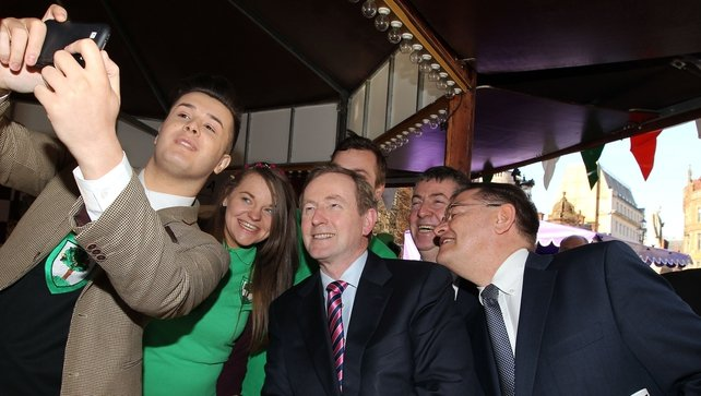 Taoiseach Enda Kenny has a 'selfie' taken with Fabian Bohan-Taghian outside the town hall in Manchester