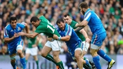 Ireland's Rob Kearney suplies some go-forward ball despite the attentions of Alberto de Marchi