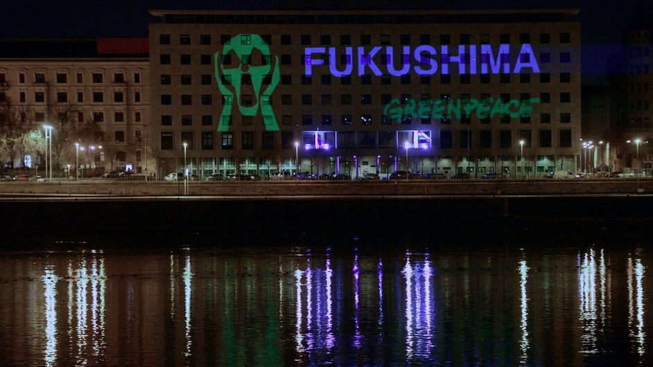 Greenpeace supporters project a message protest onto the office building of the Hungarian Parliaments' Representatives at the bank of Danube River in Budapest, during the 3rd anniversary of the Fukusima nuclear power plant disaster