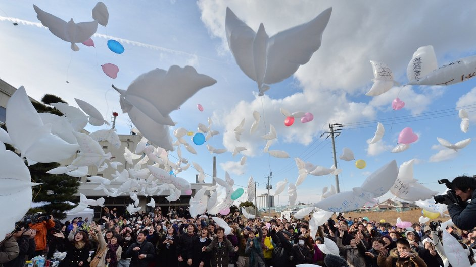Balloons in the shape of doves are released into the air during a memorial service for tsunami victims at the former Yuriage junior high school in Natori, Miyagi Prefecture