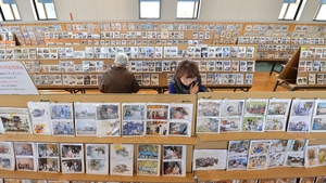 Visitors at a gymnasium in Sendai, Miyagi Prefecture look at pictures discovered in Sendai city after the disaster. About 170,000 pictures will be displayed