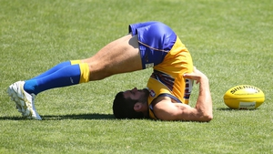 Jack Darling of the Eagles stretches during a West Coast Eagles AFL training session at Patersons Stadium