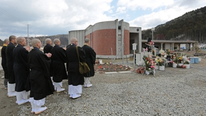 Buddhist monks offer prayers at Okawa Elementary School in Ishinomaki, Miyagi