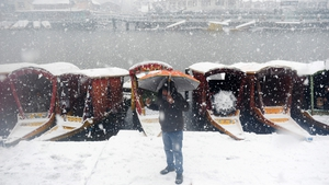 A Kashmiri resident walks during heavy snowfall in Srinagar. Indian-administered Kashmir has remained cut off from the rest of the country for a second day after heavy snow forced the Srinagar-Jammu National Highway to close