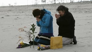 Kunie Konno and her mother Kazue, offer prayers on a beach in Arahama in Sendai, Miyagi Prefecture (Pic:EPA)