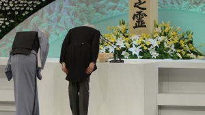 Japanese Emperor Akihito and Empress Michiko bow in front of the altar for the victims at the national memorial service in Tokyo, Japan (Pic:EPA)
