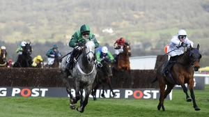 Jockey Richie McLernon on Holywell (r) clear the last to go on and win by nearly two lengths