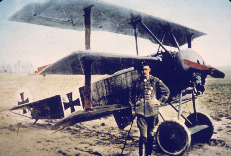 German flying ace Heinrich Gontermann (1896 - 1917) stands near his Fokker DR-1 tri-plane on an airfield in Germany in the 1910s. Gontermann, who had 39 victories as a fighter pilot, was killed in this aircraft when it broke up in the air